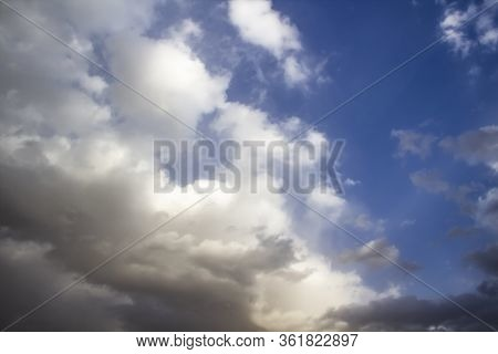 Clouds In The Blue Sky. A Stunning Gray Sky. The Storm Is Approaching. A Beautiful Clouds Against Th