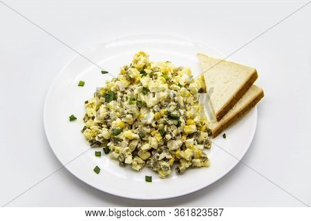 Ukrainian And Russian Salad Olivier According To A New Recipe On A White Plate. Healthy Salad Olivie
