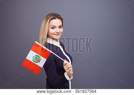 Immigration And The Study Of Foreign Languages, Concept. A Young Smiling Woman With A Peru Flag In H