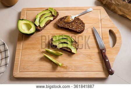 Avocado Peanut Butter Toast Ingredients On A Cutting Board For A Healthy Breakfast At Home