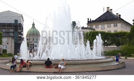 Copenhagen, Denmark - Jul 05th, 2015: Frederiks Church Marble Church And Fountain In Amaliehaven Gar