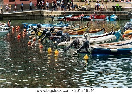 Vernazza, Liguria, Italy - July 22, 2019: Port Of The Ancient Vernazza Village With Small Boats. Cin