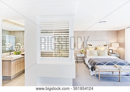 Modern Washroom And Bedroom Attached Together With Sunlight, Indoor Lighting, There Is A Window On T