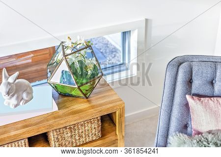 Modern Living Room With Fancy Items Like Rabbit Statue And Eight Bevel Vase Made Of Transparent Plas