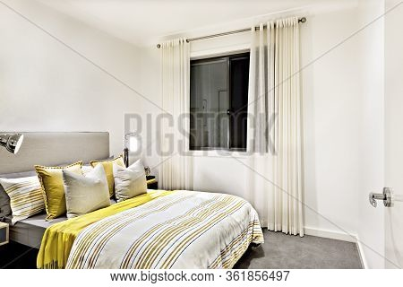 Classic Bedroom Of A Modern House With Table Lamps On Next To Pillows And Bed With Duvets, There Is