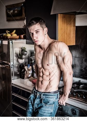 Young Muscleman Standing In House Kitchen, Shirtless