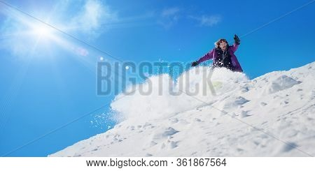 Very Fast Professional Freerider Snowboarder Rolls And Rides Snowboard Board And Make Big Splash Of