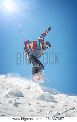 Freerider Snowboarder Jump From Hill With Snowboard And Make Splash