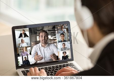 Diverse People Involved At Group Videocall View Over Man Shoulder
