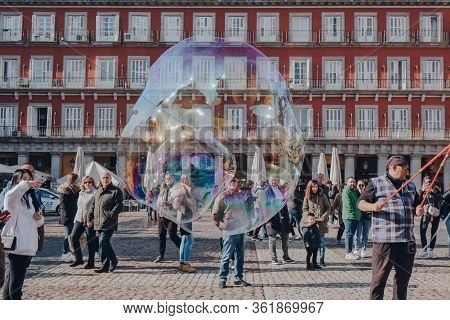 Madrid, Spain - January 26, 2020: Giant Soap Bubbles In The Air In Plaza Mayor, A Major Public Space