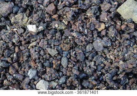 Slag From Burnt Coal. Coal Ash Close-up. Coal Solid Residue Texture. Abstract Multitask Background.