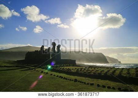 Silhouette Of Moai Statues With The Dazzling Sun And Wavy Pacific Ocean In The Backdrop, Ahu Tongari