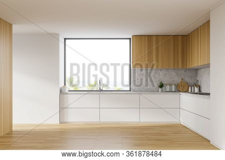 Interior Of Comfortable Kitchen With White Walls, Wooden Floor, White Countertops With Built In Sink