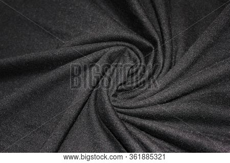 Crumpled Black Textile Texture Concept. Linen Dark Silky Black Cloth Close Up View, Wavy Wrinkled Fa