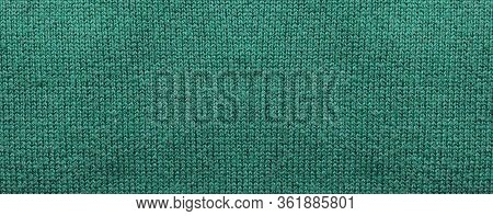 Woven Fabric Surface Rough Textured Background. Empty Dark Faded Green Color Texture, Thread Textile