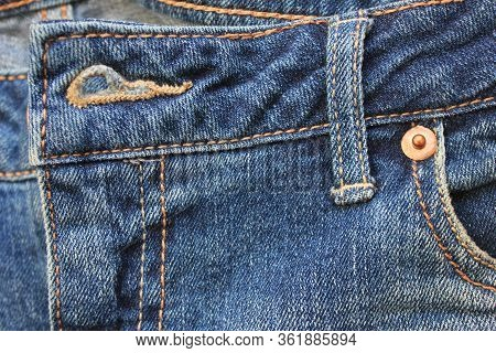 Blue Denim Jeans Design Detail With Seams And Buttonhole Close Up View. Classic Fashion Jeans Design