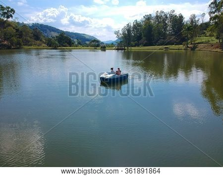 Aerial View Of Couple On The Pedal Boat On The Lake In Brazil. Drone View Of Romantic Scene Of Coupl