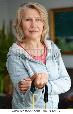 Staying Fit Is One Way To Age With Grace. Nice Elderly Woman Taking Pleasure In The Workout. Active