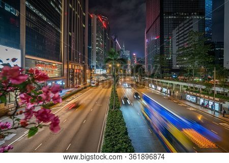 Hong Kong - 2020: Gloucester Road At Night From Above, A Wide Street With Palm Trees And Flower Beds