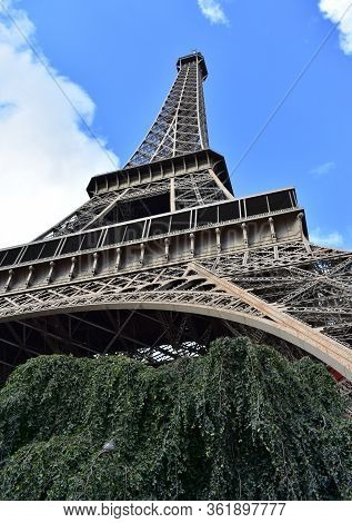 Tour Eiffel Or Eiffel Tower, Perspective From Below From Champ-de-mars. Paris, France.