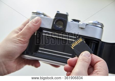 The Hand That Inserts The Usb Flash Drive Into The Film Camera.