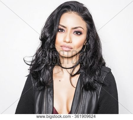 Beautiful woman with sultry makeup style and isolated against white background