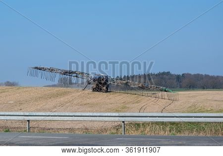 Modern Slurry Hosing, Agricultural Vehicle Is Distributing Liquid Manure Through Hoses In The Field