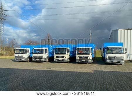 Berlin, Germany - Jan 18, 2020: Multiple Mercedes-benz Atego Trucks Next To Man Trucks Being Parked
