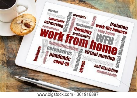 work from home word cloud on a digital tablet with a cup of coffee, social distancing, self quarantine and stay-at-home order during covid-19 coronavirus pandemic