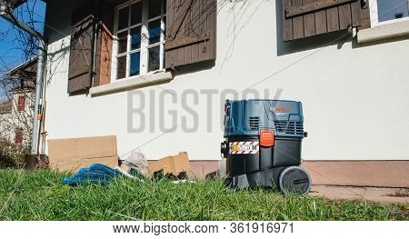 Strasbourg, France - Feb 9, 2020: Beautiful Rustic Home With New Unboxed In The Grass Yard Bosch Gas