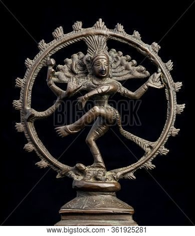 Bronze Statue Of The Hindu God Shiva  Isolated On Black. Shiva Represents Death And Dissolution, And