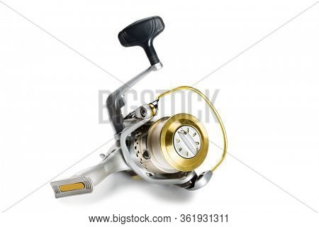 Inertialess new fishing reel isolated on white background