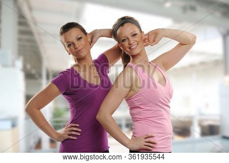 Young women steaching and workingout inside a building