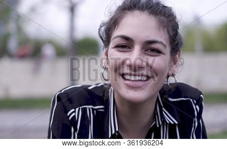 Beautiful Cool Woman In The Park Laughing And Smiling, Relaxing On The Grass.  Slow Motion 4k.