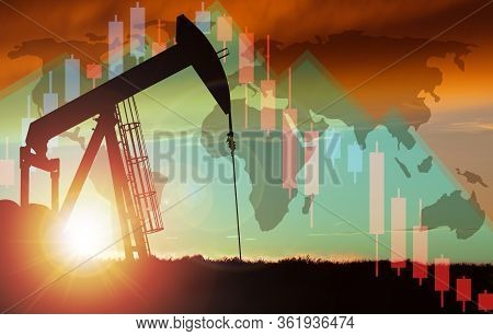 3d Rendering Of Pump Jack Silhouette Against A Sunset Sky With World Map And Declining Stock Chart B