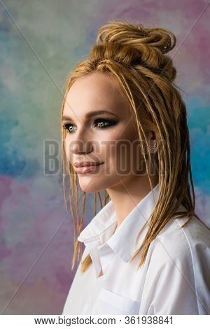High Fashion Model False Dreadlocks. Smokey Eyes. Ethnic Style. Cheeky Image. Art Salon Concept.