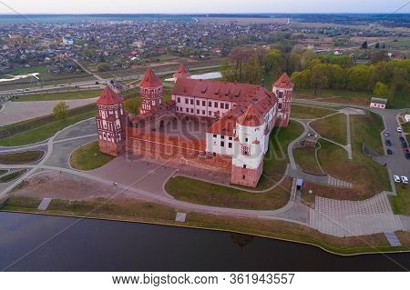 Above The Mir Castle In The Evening Of April (aerial Photography). Mir, Belarus