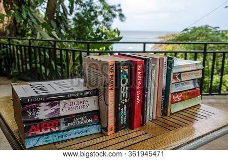 Castara, Trinidad And Tobago - January 12, 2020:  A Selection Of Popular Paperback Fiction Books Sit