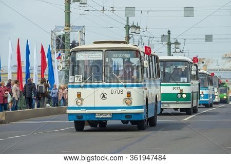 Saint Petersburg, Russia - May 25, 2019: Column Of Soviet Lviv Buses Laz On The Palace Bridge. Fragm