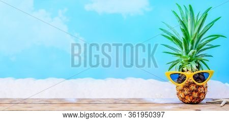 Pineapple With Sunglasses On Wood Background. Creative Minimal Summer Holiday Concept
