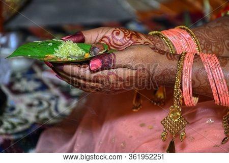 Indian Bride Kept Betel Leaf, Betel Nut On Hand For Wedding Rituals.