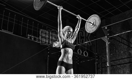 Fit And Sexy Girl Lifting Barbell In Gym Doing Crossfit. Athletic Woman Workout Fitness Exercise Tra