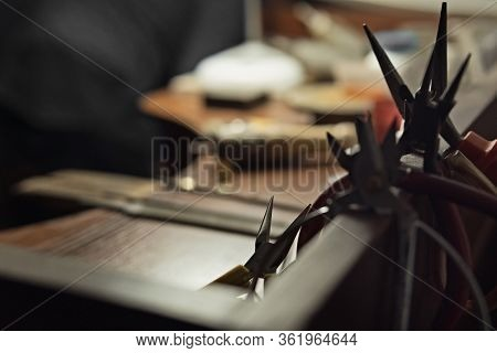 Working Desk For Craft Jewelery Making With Professional Tools. Workplace With Hand Tools. Silhouett