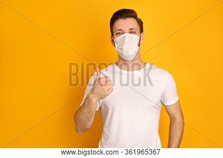 Caucasian Young Guy Wears Face White Mask To Protect Himself Against Covid19 Virus, Wants To Be Heal