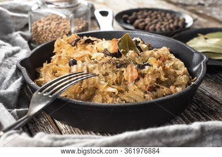 Bigos, A Traditional Polish Dish Of Sauerkraut Served In A Cast Iron Skillet.