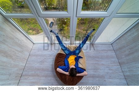 Little Boy Relaxing On A Terrace. Teenage Dreaming Of Summer Vocation Looking Through The Glass Wall