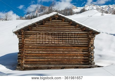 Small Wooden Shack In Winter Day With Fresh Snow In The Mountains