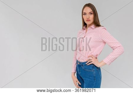 Portrait Of A Young Serious Woman Standing Monochromatic Background