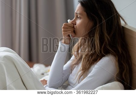 Close Up Unhappy Woman Holding Tissue, Crying, Sitting In Bed