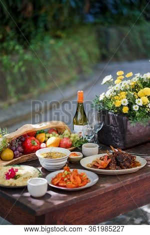 A Set Of Dishes For A Party In The Backyard.